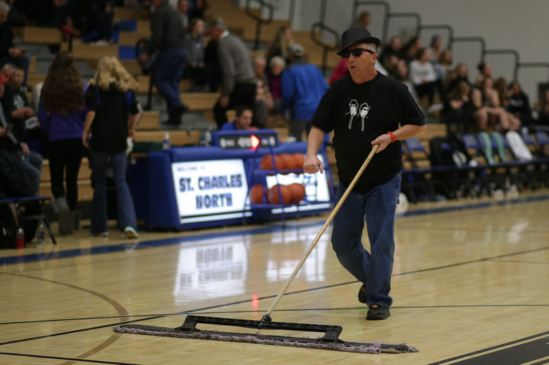 Blues Brother Sweeping the gym floor at St. Charles North HS