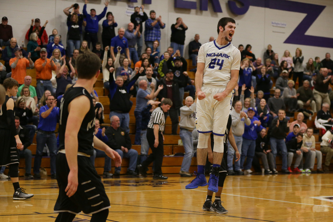 evan schomer 24 celebrates after his team defeats kaneland 66 62 in a quarter final game during the 53rd plano christmas classic basketball tournament - Plano Christmas Classic